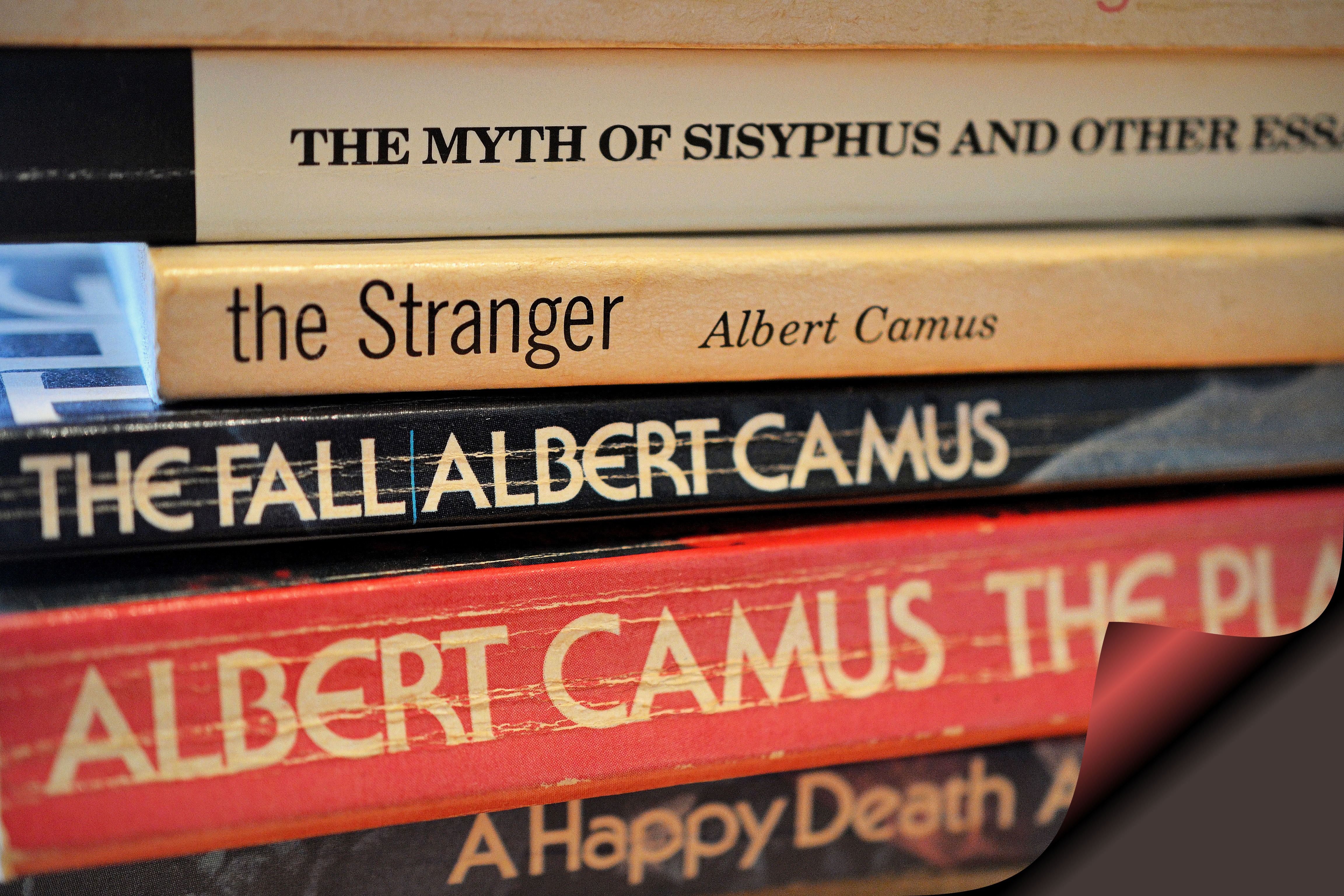an analysis of the existentialist novel written by albert camus Albert camus the stranger was in place, but the screws had been given only a few turns and their nickeled heads stuck out above the wood, which was stained dark walnut.